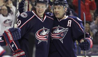 Columbus Blue Jackets' Ryan Johansen, left, and Jack Johnson celebrate Johansen's goal against the Washington Capitals during the second period of an NHL hockey game, Thursday, Jan. 30, 2014, in Columbus, Ohio. (AP Photo/Jay LaPrete)