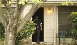IN this Feb. 21, 2013 photo, Austin police officer Ray Kianes, enters a house on Doc Holliday Trail  in Austin, Texas.  Kianes was responding to a burglar alarm at the house, but it turned out that high winds apparently pushed open a door that had not been closed properly.  Austin police respond to more than 80 burglary alarms every day, nine out of 10 of which are false, according to an Austin American-Statesman analysis of police statistics over the past five years.  (AP Photo/Austin American-Statesman, Jay Janner) AUSTIN CHRONICLE OUT, COMMUNITY IMPACT OUT, INTERNET MUST CREDIT PHOTOGRAPHER AND STATESMAN.COM