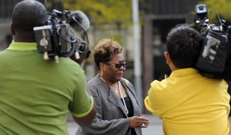 FILE- In an Oct. 4, 2012 file photo Emma Bell is followed by media outside the federal courthouse in Detroit. The woman who raised campaign money for former Detroit Mayor Kwame Kilpatrick is hoping to avoid prison for tax crimes. Bell was a key witness at Kilpatrick's corruption trial, telling jurors how she pulled cash from her bra to pay more than $200,000 in kickbacks when he was mayor. Bell is returning to court Thursday, Jan. 30, 2014 for her sentence for tax evasion. (AP Photo/The Detroit News, David Coates, FILE )  DETROIT FREE PRESS OUT; HUFFINGTON POST OUT