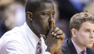 Alabama head coach Anthony Grant watches as his team fades during an NCAA basketball game against Auburn, Thursday, Jan. 30, 2014, at Auburn Arena in Auburn, Ala. (AP Photo/Alabama Media Group, Vasha Hunt)
