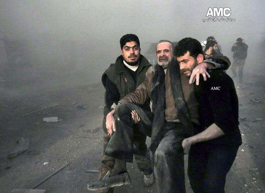 This Wednesday, Jan. 29, 2014 citizen journalism image provided by Aleppo Media Center (AMC), an anti-Bashar Assad activist group, which has been authenticated based on its contents and other AP reporting, shows Syrian men helping a wounded man from the scene after a government airstrike in Aleppo, Syria. (AP Photo/Aleppo Media Center, AMC)