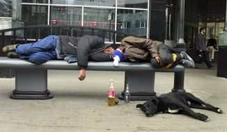 """FILE - In this Sept. 2005 file photo, men sleep after drinking on a bench in downtown Moscow. Russian men who down large amounts of vodka _ and too many do _ have an """"extraordinarily"""" high risk of an early death, a new study says. The risk of dying before age 55 for those who said they drank three or more half-liter bottles of vodka a week was a shocking 35 percent. (AP Photo/Alexei Sazonov, File)"""
