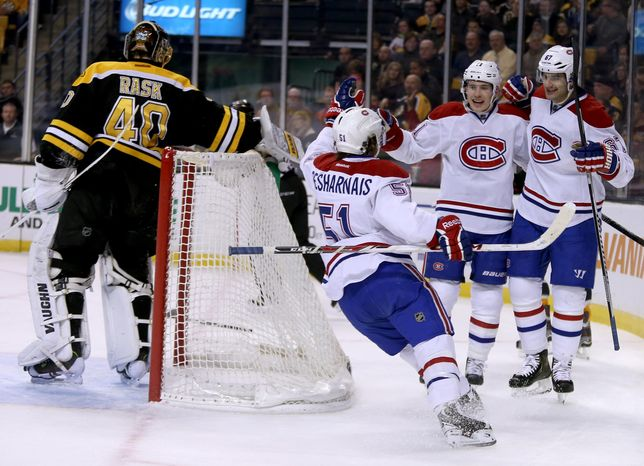Montreal Canadiens left wing Max Pacioretty (67), right, is congratulated by teammates David Desharnais (51) and Brendan Gallagher (11) after scoring on a breakaway goal against Boston Bruins goalie Tuukka Rask (40), of Finland, during the first period of an NHL hockey game on Thursday, Jan. 30, 2014, in Boston. (AP Photo/Mary Schwalm)