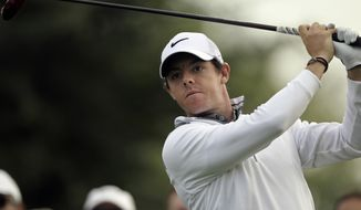 Rory McIlroy of Northern Ireland follows his ball on the 14t hole during the first round of the Dubai Desert Classic golf tournament in Dubai, United Arab Emirates, Thursday, Jan. 30, 2014. (AP Photo/Kamran Jebreili)