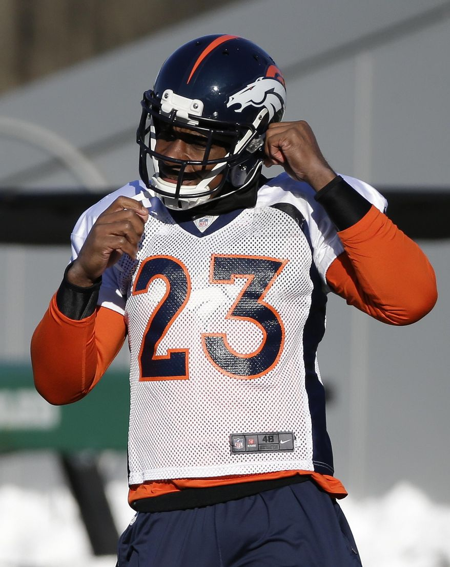 Denver Broncos cornerback Quentin Jammer straps on his helmet during practice Wednesday, Jan. 29, 2014, in Florham Park, N.J. The Broncos are scheduled to play the Seattle Seahawks in the NFL Super Bowl XLVIII football game Sunday, Feb. 2, in East Rutherford, N.J. (AP Photo/Mark Humphrey)