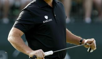Phil Mickelson reacts to a missed putt on the 16th hole during the first round of the Waste Management Phoenix Open golf tournament on Thursday, Jan. 30, 2014, in Scottsdale, Ariz. (AP Photo/Rick Scuteri)