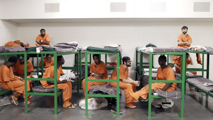 In this Dec. 10, 2013, photo inmates hang out on their bunks in a new unit in the Harris County Jail for gay, bisexual and transgender inmates in Houston. (AP Photo/Pat Sullivan)