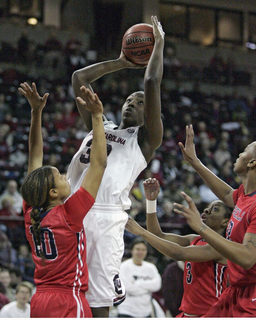 South Carolina's Elem Ibiam (33) drives for the basket as Ole Miss's Diara Moore (10) tries to block during the first half of an NCAA college basketball game Thursday, Jan. 30, 2014, in Columbia, S.C. (AP Photo/Mary Ann Chastain)