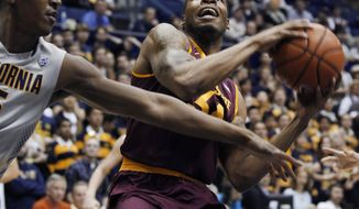 Arizona State's Jermaine Marshall, right, drives for the basket as California's Jordan Mathews defends during the first half of an NCAA college basketball game, Wednesday, Jan. 29, 2014, in Berkeley, Calif. (AP Photo/George Nikitin)