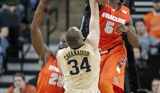 Syracuse's C.J. Fair (5) blocks a shot by Wake Forest's Tyler Cavanaugh (34) during the second half of an NCAA college basketball game in Winston-Salem, N.C., Wednesday, Jan. 29, 2014. Syracuse won 67-57. (AP Photo/Chuck Burton)