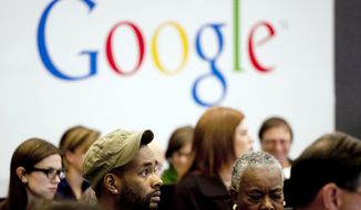 "FILE - In this Wednesday, Oct. 17, 2012, file photo, people attend a workshop, ""New York Get Your Business Online,"" at Google offices in New York. Google Inc. reports quarterly earnings on Thursday, Jan. 30, 2014.  (AP Photo/Mark Lennihan, File)"