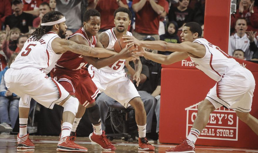 Nebraska  guard/forward Terran Petteway (5) and  guard Tai Webster (0) go for a loose ball against Indiana  forward Hanner Mosquera-Perea (12) during an NCAA college basketball game, Thursday, Jan. 30, 2014 in Lincoln, Neb.(AP Photo/Dave Weaver)