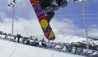 In this Dec. 14, 2013, file photo, Arielle Gold competes during the snowboarding superpipe final at a Dew Tour event in Breckenridge, Colo. Taylor and Arielle Gold are taking their brother and sister act to Sochi. The Golds are members of the U.S. Olympic halfpipe snowboarding team that is expected to come home from Russia with multiple medals. (AP Photo/Julie Jacobson, File)