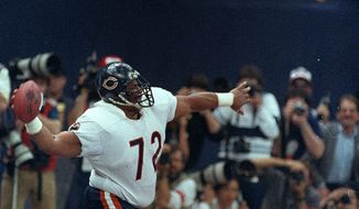 "Chicago Bears' William ""The Refrigerator"" Perry spikes the ball after scoring a touchdown in Super Bowl XX in New Orleans, La., on Jan. 26, 1986.  The Bears won 46-10, scoring the most points in Super Bowl history.  (AP Photo/Amy Sancetta)"