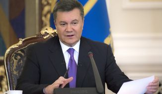 ** FILE ** In this Thursday, Dec. 19, 2013, file photo Ukrainian President Viktor Yanukovych speaks during a press conference in Kiev, Ukraine. Yanukovych is taking sick leave on Thursday, Jan. 30, 2014, as the country's political crisis continues without signs of resolution. (AP Photo/Mykhailo Markiv, Pool)