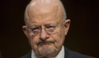 In this Jan. 29, 2014, photo, Director of National Intelligence James Clapper listens as he testifies on Capitol Hill in Washington, before the Senate Intelligence Committee hearing on current and projected national security threats against the U.S. Clapper, said this week that the loss of state secrets as a result of leaks by former National Security Agency analyst Edward Snowden was the worst in American history.  (AP Photo/Pablo Martinez Monsivais)