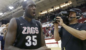 Gonzaga's Sam Dower (35) celebrates after making a shot in the final seconds to beat Santa Clara 54-52 in a NCAA college basketball game Wednesday, Jan. 29, 2014, in Santa Clara, Calif. (AP Photo/Tony Avelar)