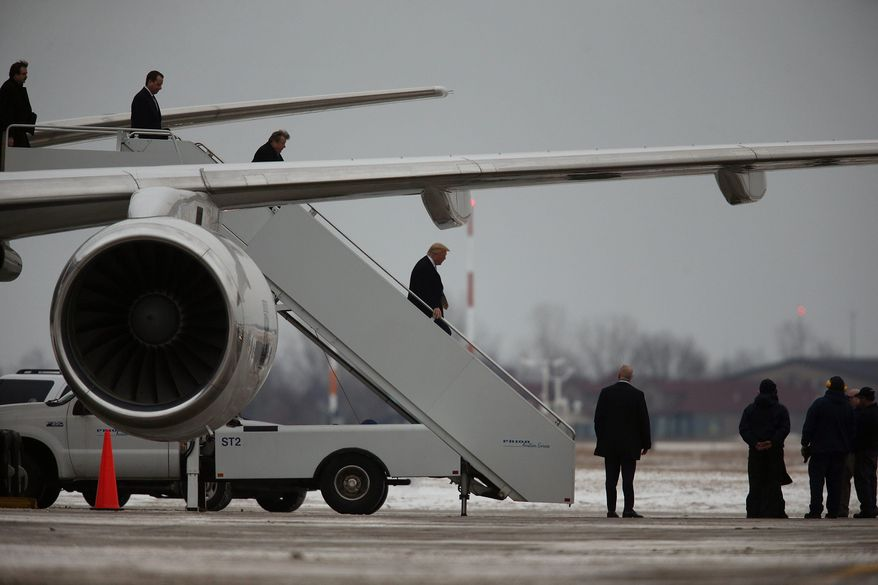 Donald Trump exits his privately-owned Boeing 757 on the runway at Buffalo Niagara International Airport in Cheektowaga, N.Y. Friday, Jan. 31, 2014. Trump has been exploring a run for New York State Governor against Andrew M. Cuomo, the Democratic incumbent. (AP Photo/The Buffalo News, Charles Lewis)