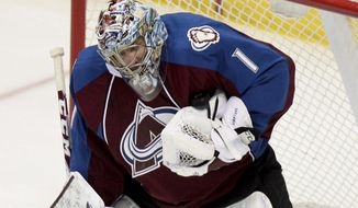 Colorado Avalanche goalie Semyon Varlamov (1), of Russia, makes a save against the Minnesota Wild during the first period of an NHL hockey game Thursday, Jan. 30, 2014, in Denver. (AP Photo/Barry Gutierrez)