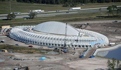 This photo taken Jan. 20, 2014, shows the Innovation, Science and Technology Building designed by architect Santiago Calatrava under construction at Florida Polytechnic University in Lakeland, Fla. (AP Photo/The Ledger,  Scott Wheeler)