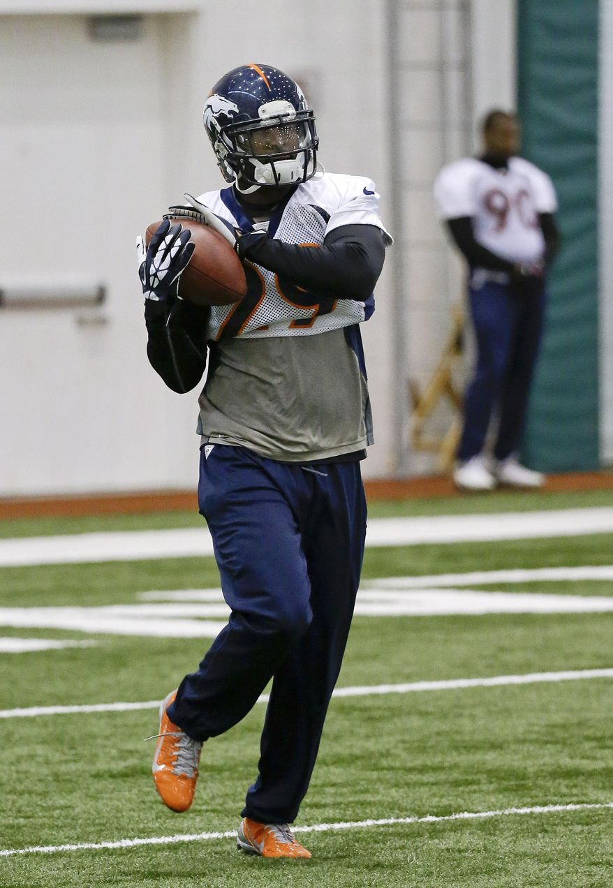 Denver Broncos free safety Michael Huff catches a pass during practice Friday, Jan. 31, 2014, in Florham Park, N.J. The Broncos are scheduled to play the Seattle Seahawks in the NFL Super Bowl XLVIII football game Sunday, Feb. 2, in East Rutherford, N.J. (AP Photo/Mark Humphrey)