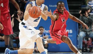 Richmond guard Kendall Anthony, right, tries unsuccessfully to force a turnover by Saint Louis University guard Austin McBroom during the first half of an NCAA basketball game, Wednesday, Jan. 29, 2014 in St. Louis. (AP Photo/St. Louis Post-Dispatch, Chris Lee)  EDWARDSVILLE INTELLIGENCER OUT; THE ALTON TELEGRAPH OUT