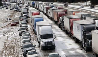 Traffic is at a standstill on Interstate 459 at US highway 280 as officials work to clear abandoned vehicles Wednesday January 29,  2014 in Birmingham,  Ala. The winter storm that hit Alabama on Tuesday was wider and more severe than many officials expected.  (AP Photo/Hal Yeager)
