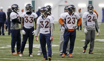 Denver Broncos defensive players Duke Ihenacho (33), Tony Carter (32), Quentin Jammer (23) and Champ Bailey (24) wait to begin a drill during practice Friday, Jan. 31, 2014, in Florham Park, N.J. The Broncos are scheduled to play the Seattle Seahawks in the NFL Super Bowl XLVIII football game Sunday, Feb. 2, in East Rutherford, N.J. (AP Photo/Mark Humphrey)