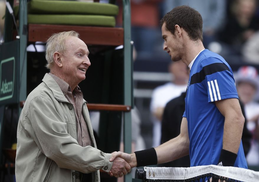 Tennis Hall-of-Famer Rod Laver, who won 11 Grand Slam titles and 200 tournaments, shakes hands with Britain's Andy Murray prior to flipping the coin for Murray's Davis Cup match against Donald Young, of the United States, Friday, Jan. 31, 2014, in San Diego. (AP Photo/Lenny Ignelzi)