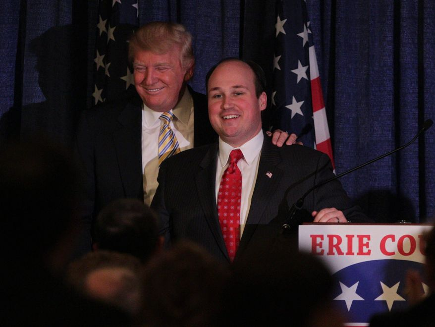 Donald Trump was the guest of honor and keynote speaker at the Erie County Republican Committee Lincoln Leadership Reception at Salvatore's Italian Gardens in Cheektowaga, N.Y. Friday, Jan. 31, 2014.  Erie County Republican Chairman Nick Langworhy thanks Trump after he concludes his speech. (AP Photo/The Buffalo News, Sharon Cantillon)