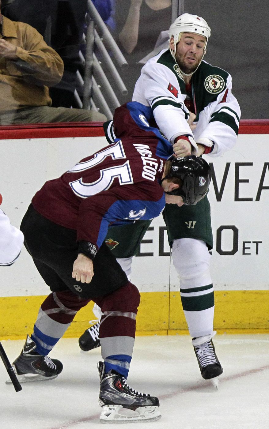 Minnesota Wild's Clayton Stoner, top, takes a swing at Colorado Avalanche's Cody McLeod, bottom, during the first period of an NHL hockey game Thursday, Jan. 30, 2014, in Denver. (AP Photo/Barry Gutierrez)