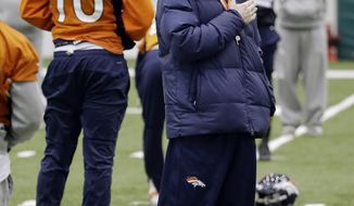 Denver Broncos head coach John Fox watches his players stretch during practice Friday, Jan. 31, 2014, in Florham Park, N.J. The Broncos are scheduled to play the Seattle Seahawks in the NFL Super Bowl XLVIII football game Sunday, Feb. 2, in East Rutherford, N.J. (AP Photo/Mark Humphrey)