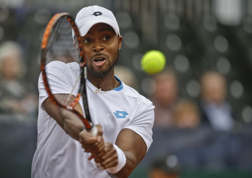 Donald Young, of the United States, returns a shot against Britain's Andy Murray during a Davis Cup tennis match at Petco Park  Friday, Jan. 31, 2014, in San Diego. Murray won the match 6-1, 6-2, 6-3. (AP Photo/Lenny Ignelzi)