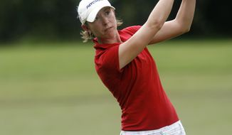 FILE - In this Sept. 11, 2008, file photo, Danielle Downey hits from the fairway on the ninth hole during the first round of the Bell Micro LPGA Classic golf tournament at Magnolia Grove Golf Course in Mobile, Ala. Downey, a former Auburn and LPGA player, died in a single-car accident in Auburn, Ala., Thursday, Jan. 30, 2014. She was 33.  Downey was in her second season as Auburn's director of golf operations. (AP Photo/The Press-Register, Bill Starling, File) MAGS OUT
