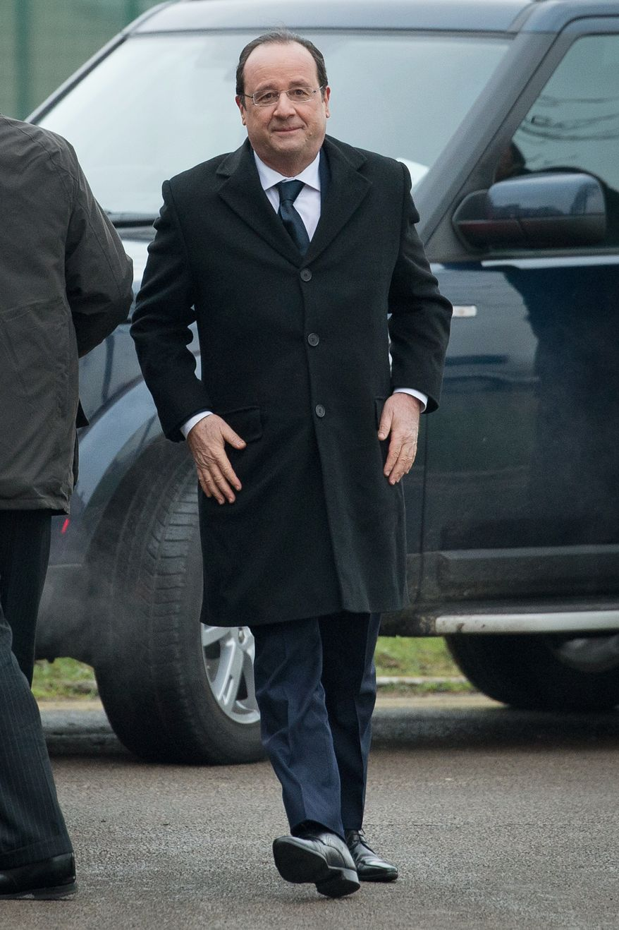 French President Francois Hollande arrives ahead of a meeting with British Prime Minister David Cameron, during a one day summit at RAF Brize Norton, England Friday Jan. 31, 2014.  British Prime Minister David Cameron and French President Francois Hollande are expected to discuss military cooperation during the one-day summit. (AP Photo / Leon Neal)