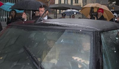 Amanda Knox co-defendant Raffaele Sollecito, at right driving the car, leaves the Udine police station, northern Italy, Friday, Jan 31, 2014. Police on Friday found Amanda Knox's ex-boyfriend near Italy's border with Slovenia and Austria, hours after he and the American student were convicted for a second time in the death of British student Meredith Kercher. They brought him to the Udine police station, took his passport and put a stamp in his Italian identity papers showing that he cannot leave the country, as mandated by the appeals court in Florence. (AP Photo/Paolo Giovannini)