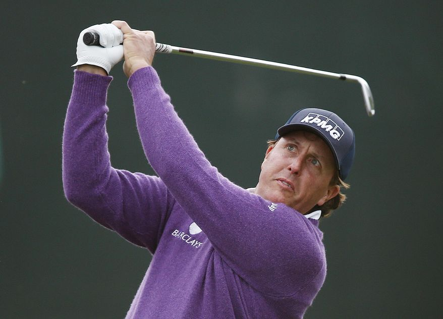 Phil Mickelson hits his tee shot at the 16th hole during the second round of the Phoenix Open golf tournament Friday, Jan. 31, 2014, in Scottsdale, Ariz. (AP Photo/Ross D. Franklin)