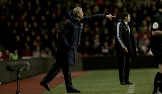 Arsenal's French manager Arsene Wenger points from the sideline during the English Premier League soccer match between Southampton and Arsenal at St Mary's stadium in Southampton, Tuesday, Jan. 28, 2014.  (AP Photo/Matt Dunham)