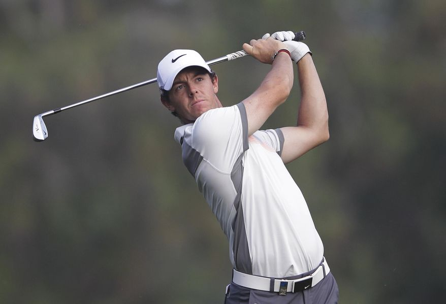 Rory McIlroy of Northern Ireland follows his ball on the 18th hole during the second round of the Dubai Desert Classic golf tournament in Dubai, United Arab Emirates, Friday Jan. 31, 2014. (AP Photo/Kamran Jebreili)