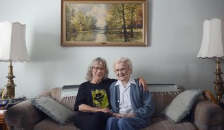 """In this Jan. 8, 2014 photo, Helen Caldwell, left, who was the script supervisor on the AMC television series """"Breaking Bad,"""" poses for a photo in her childhood home in Peoria, Ill., with her mother, Mary. Caldwell who will also serve the same role on the upcoming spinoff """"Better Call Saul,"""" has been working at her craft for more than 30 years. (AP Photo/Journal Star, David Zalaznik)"""