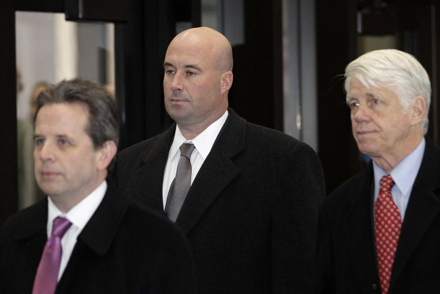 FILE - In this Dec. 10, 2012 file photo, Richard Vanecko, nephew of former Chicago Mayor Richard Daley, center, accompanied by attorneys Mark Martin, left, and Tom Breen, arrives at the Leighton Criminal Courts Building in Chicago for his arraignment on involuntary manslaughter charges. On Friday, Jan. 31, 2014, at a Rolling Meadows, Ill., courthouse, Vanecko pleaded guilty to involuntary manslaughter as part of a deal with a special prosecutor in the death of a man he got into a fight with outside a bar in 2004. (AP Photo/M. Spencer Green, File)