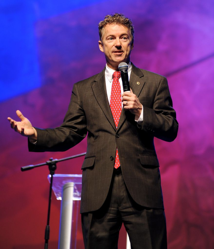 ** FILE ** Sen. Rand Paul, R-Ky., speaks during a meeting for the Arkansas Republican Party at the Hot Springs Convention Center in Hot Springs, Ark., on Friday, Jan. 31, 2014. Paul says he believes Republicans could lure young voters if they focus on privacy issues following the revelations about the National Security Agency's surveillance. (AP Photo/The Sentinel-Record, Mara Kuhn)