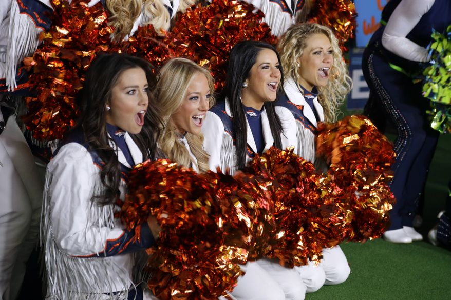 Denver Broncos cheerleaders cheer Friday, Jan. 31, 2014 during a live broadcast of Good Morning America at Times Square in New York. The Seattle Seahawks will play the Broncos Sunday in the NFL Super Bowl XLVIII football game in East Rutherford, N.J. (AP Photo/Ted S. Warren)