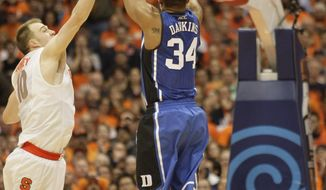 Duke's Andre Dawkins (34) shoots against Syracuse's Trevor Cooney, left, in the second half of an NCAA college basketball game in Syracuse, N.Y., Saturday, Feb. 1, 2014. The basket sent the game into overtime. Syracuse won 91-89. (AP Photo/Nick Lisi)