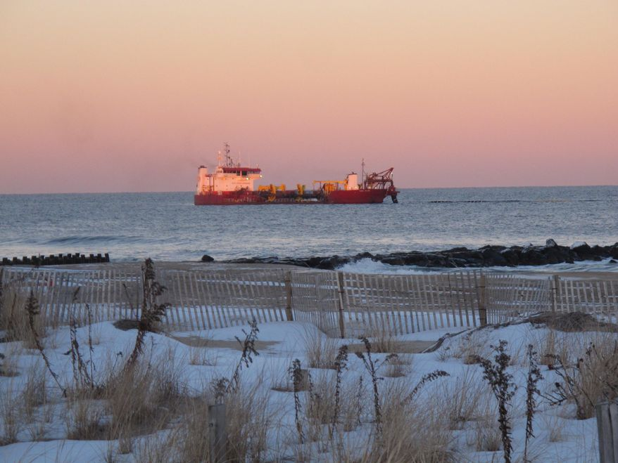 In this Jan. 30, 2014 photo, a dredge ship works off the coast of Asbury Park, N.J., part of beach replenishment work going on along much of new jersey's coastline in the aftermath of Superstorm Sandy. (AP Photo/Wayne Parry)