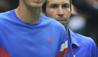 Tomas Berdych, left, and Radek Stepanek, right, from the Czech Republic play during their Davis Cup first round doubles match against Robin Haase and Jean-Julien Rojer from the Netherlands in Ostrava, Czech Republic, Saturday, Feb. 1, 2014. (AP Photo,CTK/Jaroslav Ozana) SLOVAKIA OUT