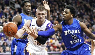 Northern Iowa's Seth Tuttle, center, loses control of the ball as Indiana State's Devonte Brown hits it away during the first half of an NCAA college basketball game Saturday, Feb. 1, 2014, in Cedar Falls, Iowa. (AP Photo/The Waterloo Courier, Courtney Collins)