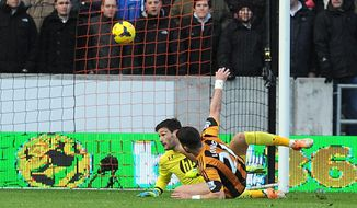 Hull City's Shane Long, front, scores his side's first goal against Tottenham goalkeeper Hugo Lloris during their English Premier League soccer match at the KC Stadium, Hull, England, Saturday, Feb. 1, 2014. (AP Photo/Anna Gowthorpe, PA Wire)   UNITED KINGDOM OUT  -  NO SALES  -  NO ARCHIVES