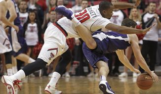 Texas Tech's Jaye Crockett and TCU's Hudson Price scramble for the ball during an NCAA college basketball game in Lubbock, Texas, Saturday, Feb, 1, 2014. (AP Photo/Lubbock Avalanche-Journal, Tori Eichberger)
