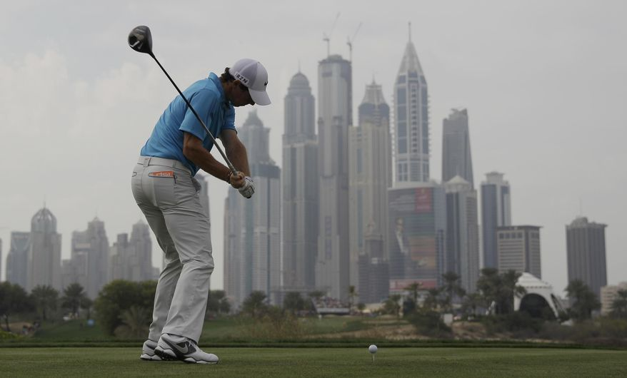 Rory McIlroy of Northern Ireland tees off on the 8th hole during the third round of the Dubai Desert Classic golf tournament in Dubai, United Arab Emirates, Saturday, Feb. 1, 2014. (AP Photo/Kamran Jebreili)